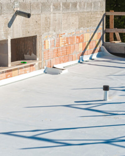 Worker,Applies,Pvc,Membrane,Roller,On,Roof,Very,Carefully.,Correct